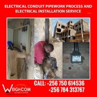 Power line construction in Uganda